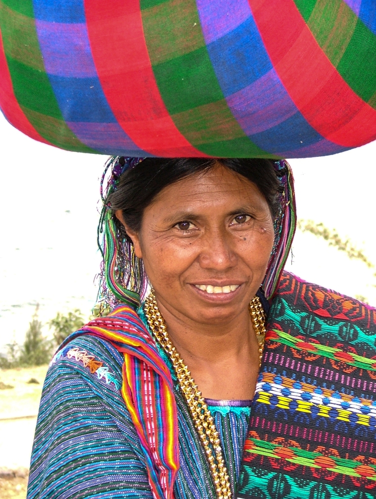 Woman Carrying Bundle On Her Head